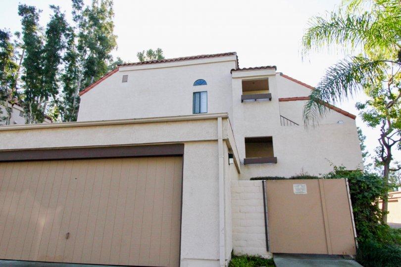 A garage sitting below a three story housing structure in Village Green in Garden Grove CA