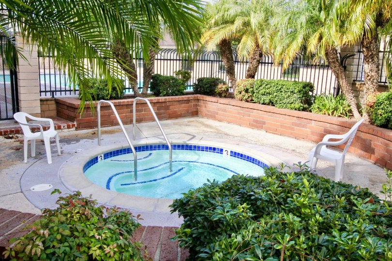 The Westbrook in the Garden Grove with a beautiful Swimming Pool and trees