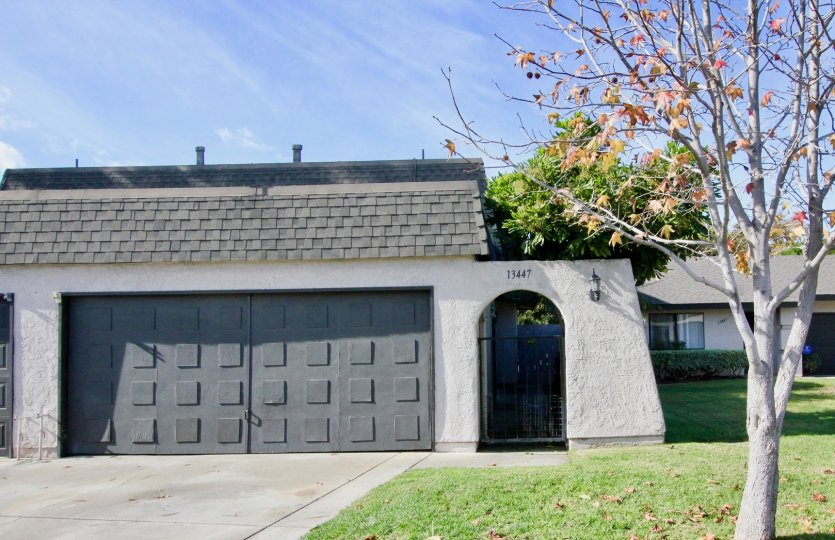 A house with massive entrance with car parking and granden at Willow Trail Garden Groe California
