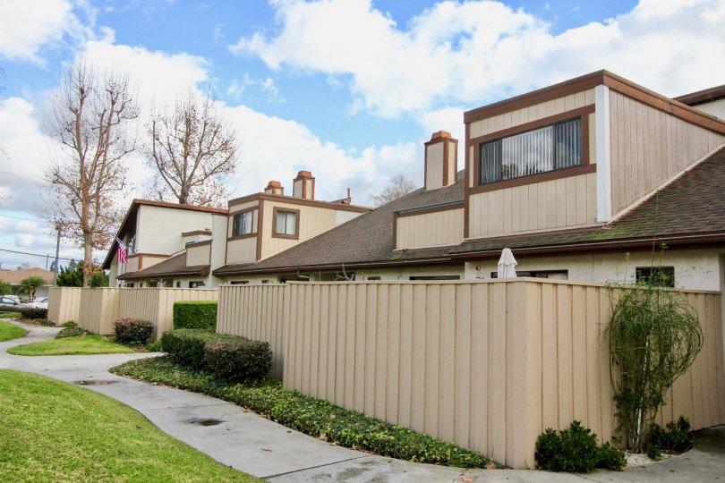 A row of condominiums with fenced-in backyards in the Yockey Condominiums area of Garden Grove, California.
