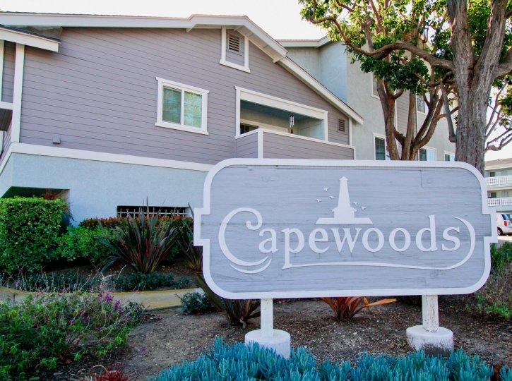 Wonderful Coloured villa with Sign board and trees around in Capewoods of Huntington Beach