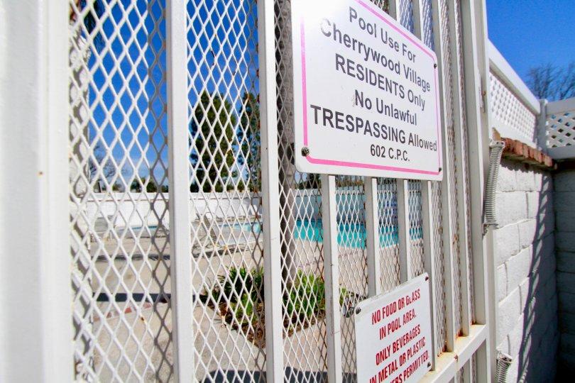 A Warning Board near swimming pool in Cherrywood Village of Huntington Beach