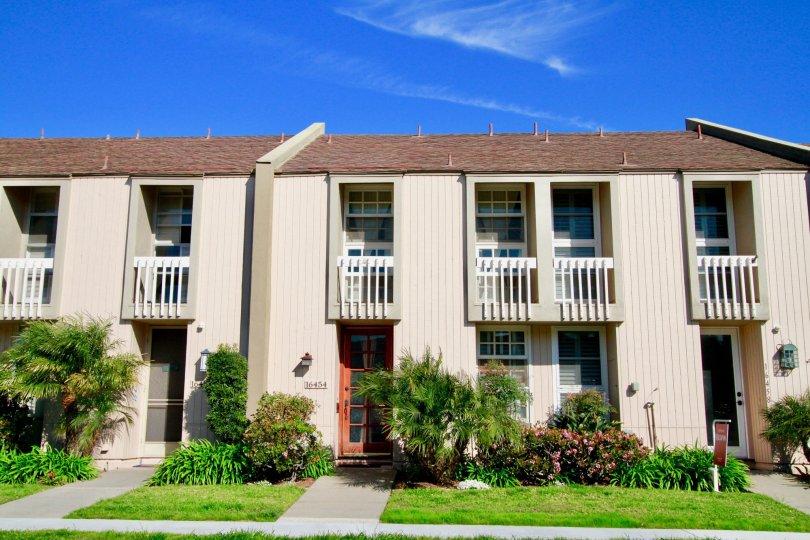 Christiana Bay Huntington Beach California box type house huge balcony light rose paint and window