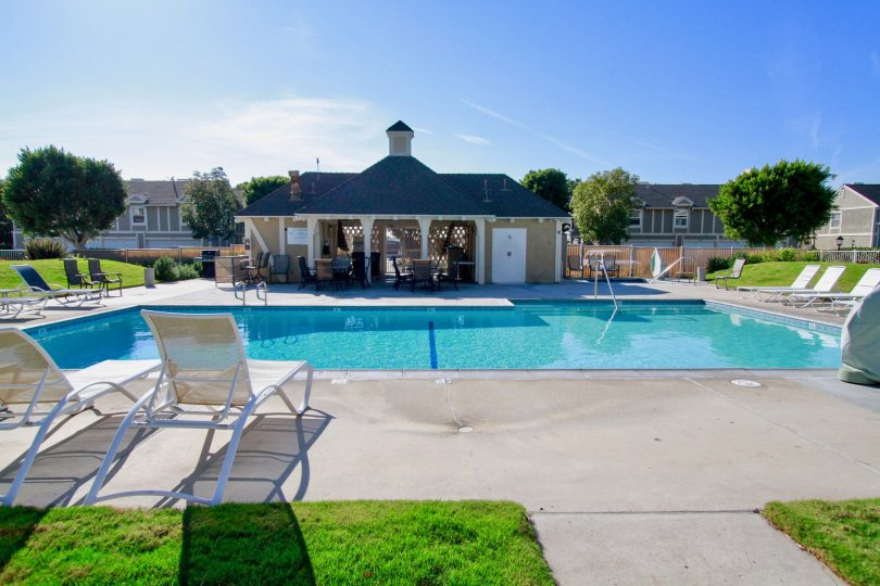Awesome Clear water swimming pool having sitout near villas in Gables of Huntington Beach