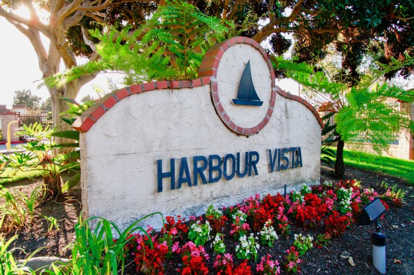 the harbour vista the sign board is backside tree is good in huntington beach in california