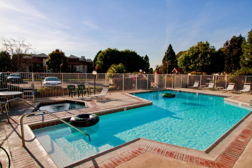 Beautiful view of swimming pool with trees around in Harbour Vista of Huntington Beach