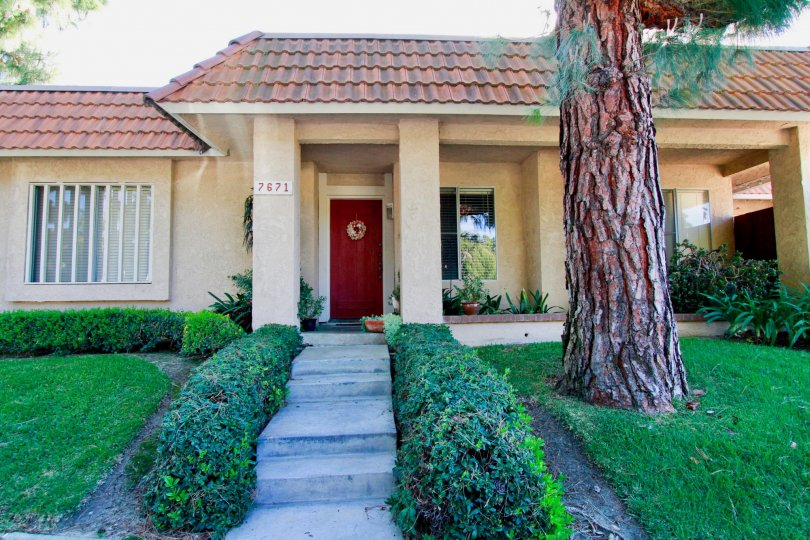 Beautiful villa with entrance view and a lawn in Hutington Creek of Huntington Beach