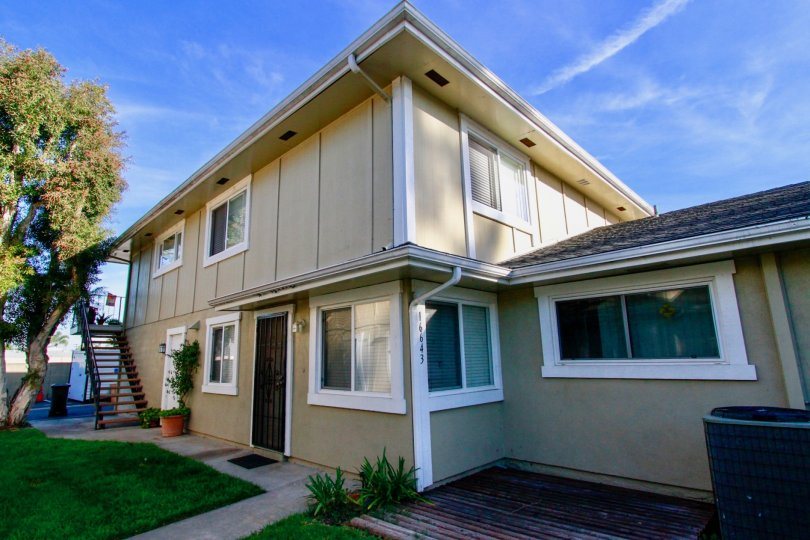 Lovely Modern Style living in Huntington Gardens Community Located in Huntington Beach California. Central Cooling, Stained Glass and lots of grass.