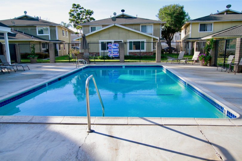 Beautiful looking swimming pool with sitting between villas of Huntington Gardens of Huntington Beach