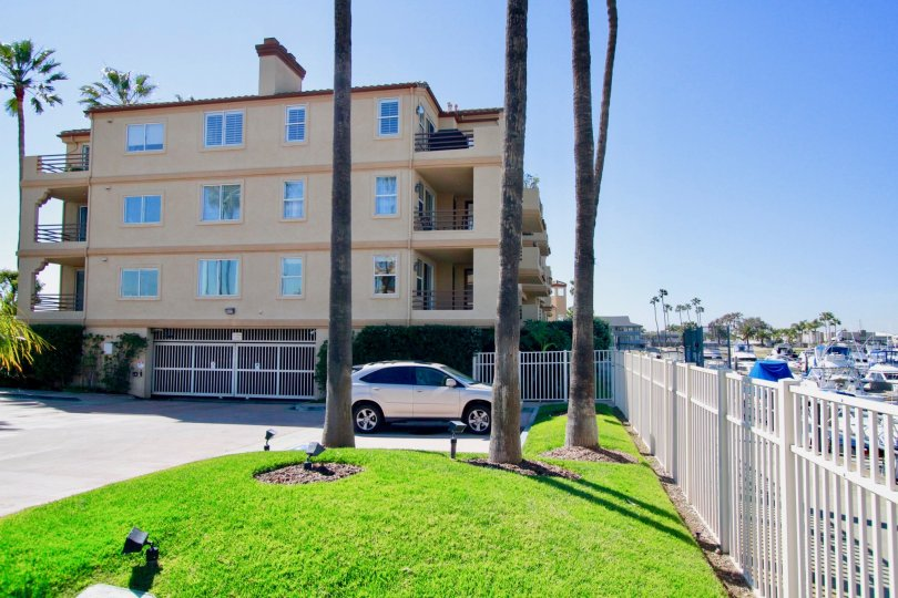 Huntington Harbour Bay Club Huntington Beach California building color light yellow ang glass attached car parking place very huge wall gate attached top very big pillar attached