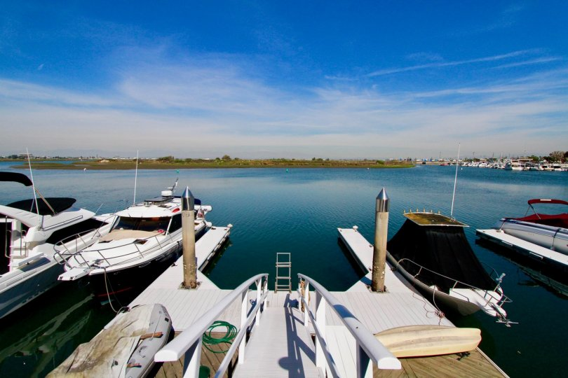 A beautiful view of the water and boats docked in the Huntington Marina.