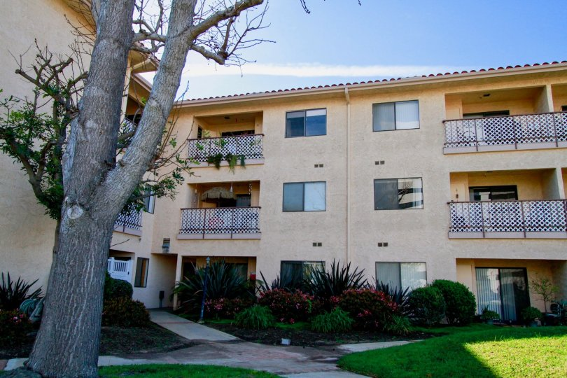 Villa having balconies and lawn in front of Huntington West of Huntington Beach
