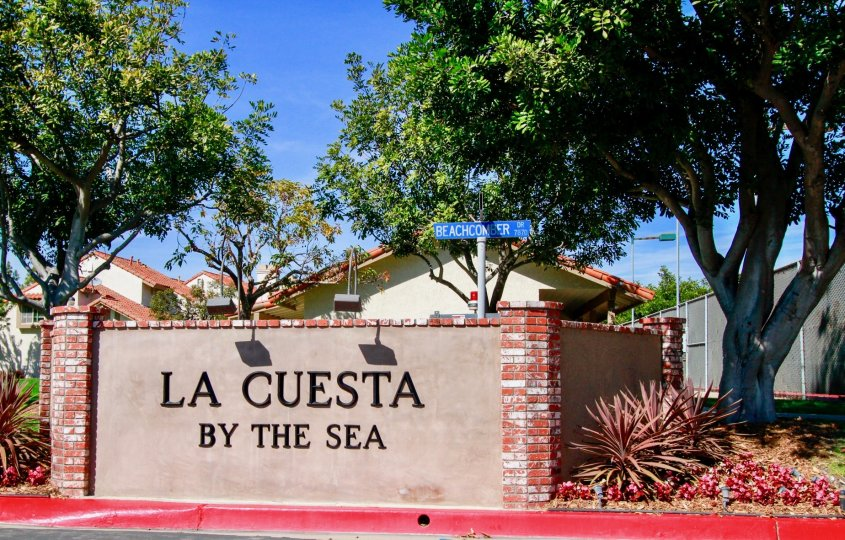 In a sunny day a brick designed LA cuesta by the sea in the city of Huntington Beach, CA with trees but without any person.