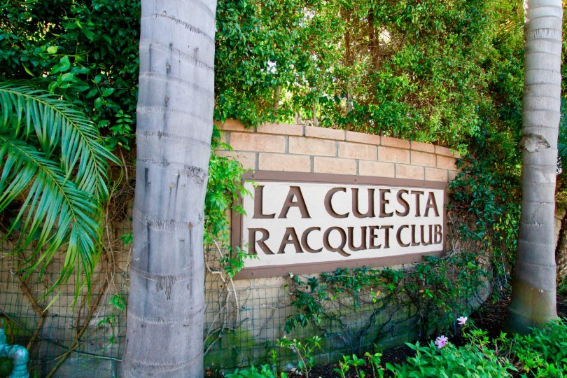 Beautiful Sign board surrounded with garden and palm trees in La Cuesta Racquet Club