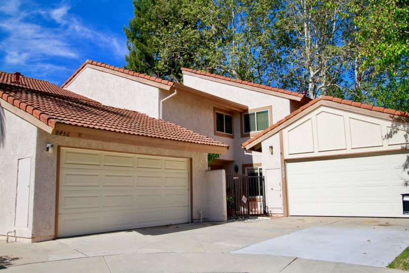 Home with multiple garages, two stories located in La Cuesta Tennis Club community in Huntington Beach, CA