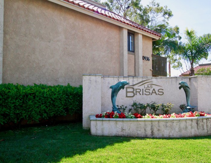 Nice Name board of villa with two dolphins and surrounded with trees in Las Brisas of Huntington Beach