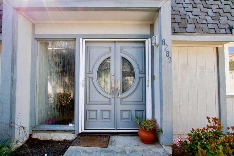 Beautiful looking villa with entrance door and small plants in Mariners Cove West of Huntington Beach