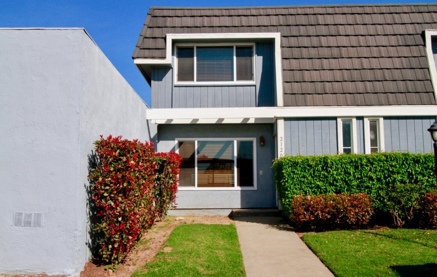 Mariners Cove Huntington Beach California building light gray color paint front glass window attached bricks colour brown