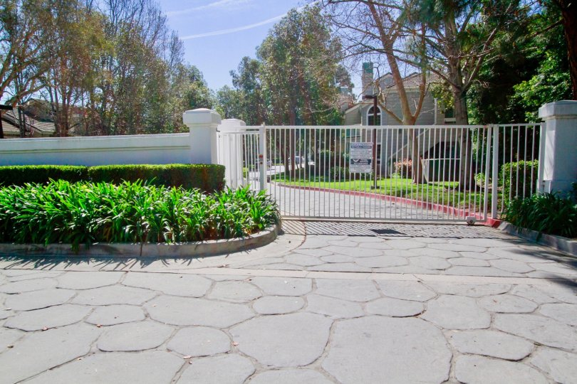 Gated residential community with well kept landscaping on a sunny and beautiful day in Huntington Beach California