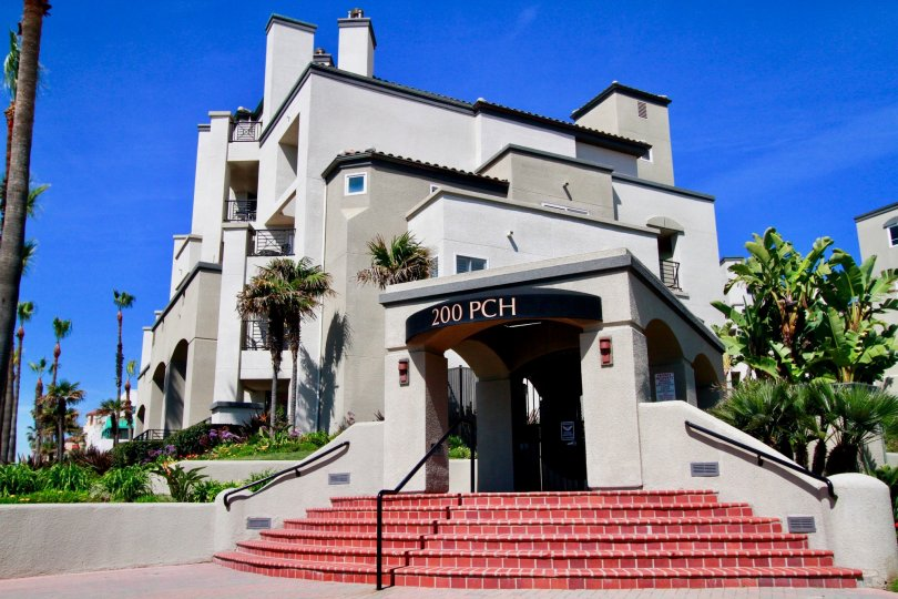 The entrance of a condominiums unit located on highway 101 on a sunny day in Huntington Beach California