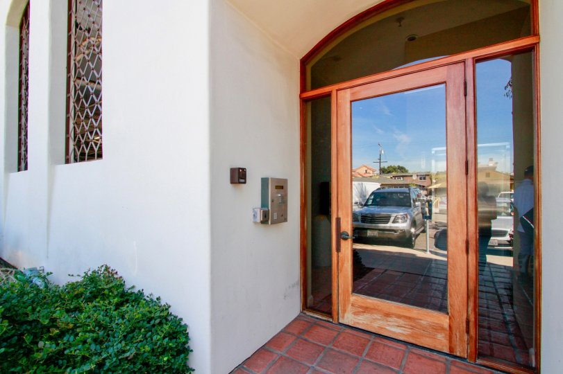 Villa showing nice entrance glass door with car parking in Plaza Almeria of Huntington Beach