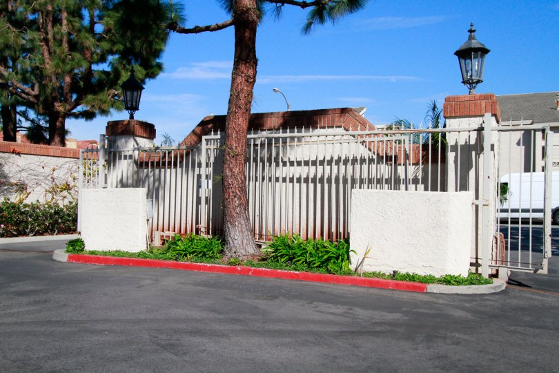Pointe Surfside Huntington Beach California building fully cover the compount gate not view for the house light attached in the gate