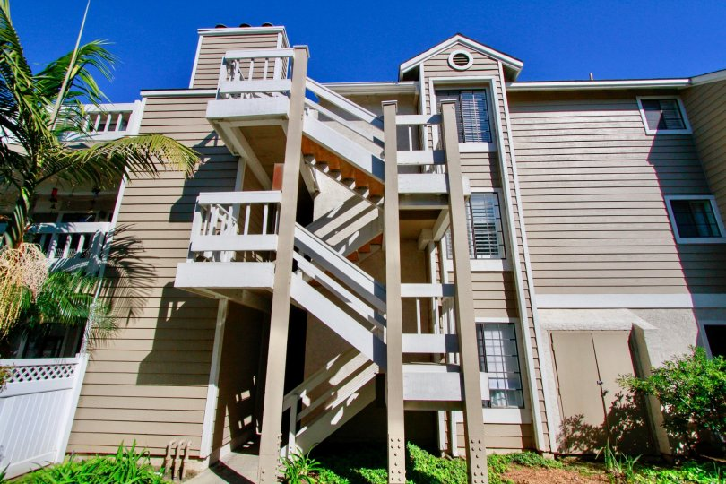 Pointe Surfside apartment building staircase on a sunny day.