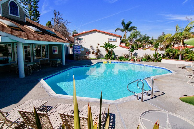 Marvellous looking swimming pool at centre with sitting near villas in Pointe Surfside of Huntington Beach