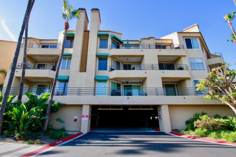Beautiful entrance view of an apartment with trees around in Portofino Cove of Huntington Beach