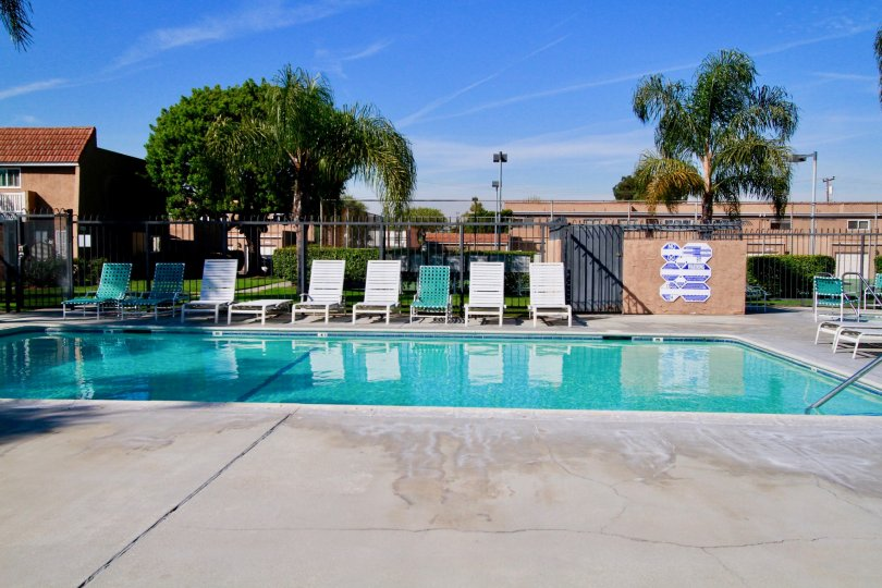 Riviera Huntington Huntington Beach California building brown paint steel door attached swmming pool bench water attached