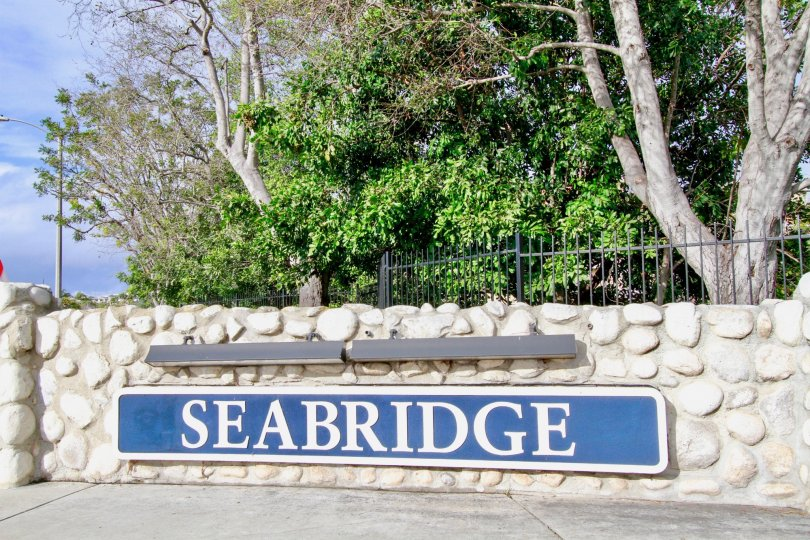 THE SEABRIDGE VILLAS THE SIGN BOARD IS DESIGN FOR ROCKS IS NICE IN HUNTINGTON BEACH IN CA