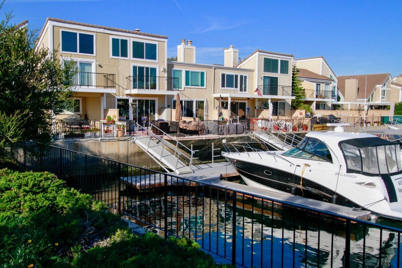 Town homes painted light brown with their own private marina and dock. Located in Huntington Beach California.