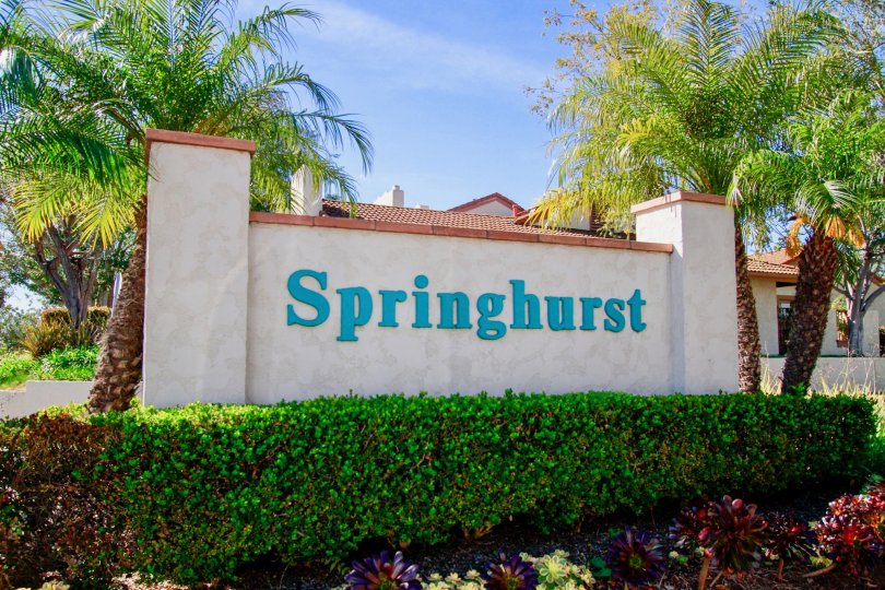 Springhurst Huntington Beach California building not viewcover for the name sign light rose color paint front big tree attached view to sky name board letter blue color