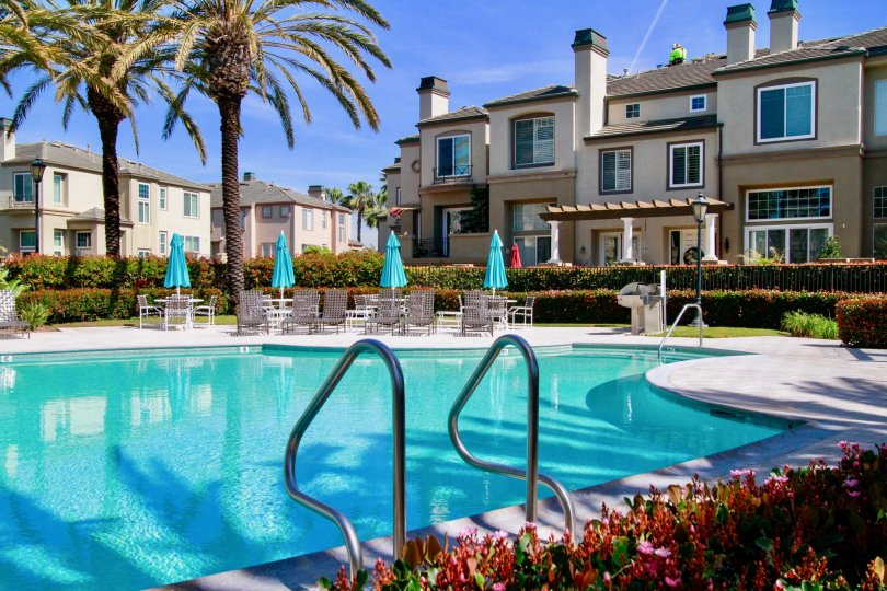A view of the community pool and townhomes at Surfcrest in Huntington Beach, CA