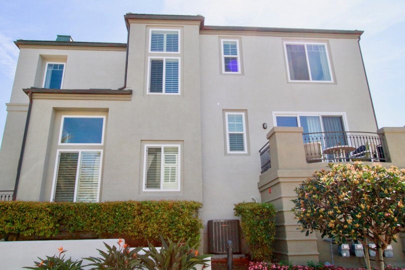 Surfcrest Huntington Beach California building color light window and glass attached house near compont wall and steel attached