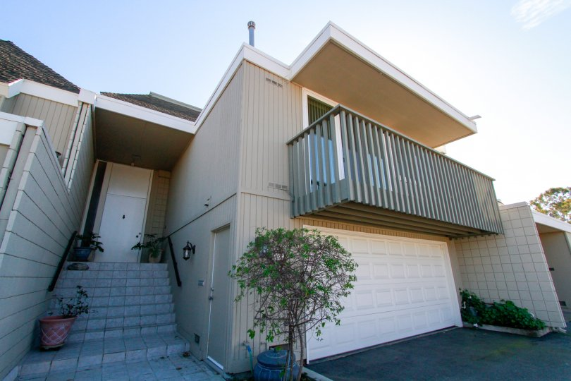 the simple home with lot of steps and a balcony which is suitated in tennis estate of huntington beach, california