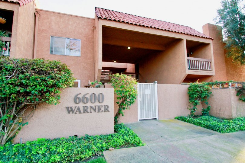 Villa Warner Huntington Beach California building color brown paint balcony gate attached wall light attached name sign board attached
