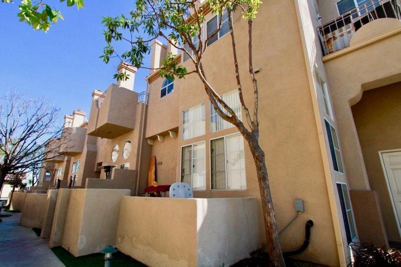 Excellent villas with balconies and trees around in Villas at Huntington Beach