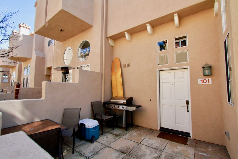 Villas at Huntington Huntington Beach California building is brown paint and light door bench chair attached