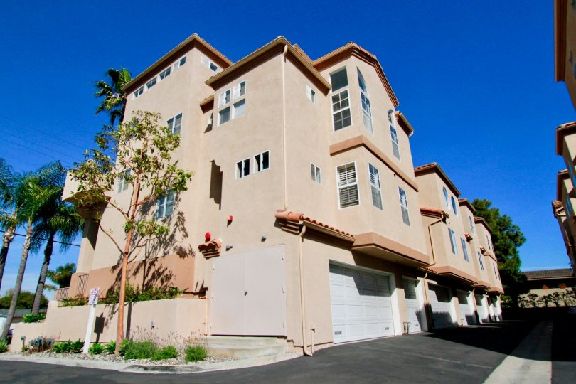 View of the back of townhomes in the Villas at Huntington Beach, located in Huntington Beach, CA