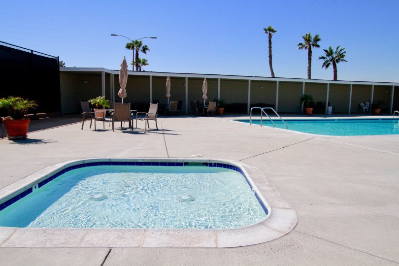 Weatherly Bay Huntington Beach California building brown paint two swmming pool bench water attached