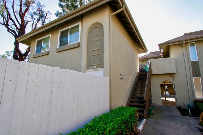 Yorktown Villas Huntington Beach California building is very super biscuts color paint apply glass window attached side steps coverded backside tree