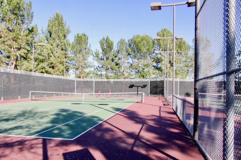 Tennis court on a sunny day in Aldea, Irvine, California
