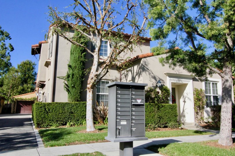A house with massive entrance and a post box for a group of house in Ambridge Irvine californis