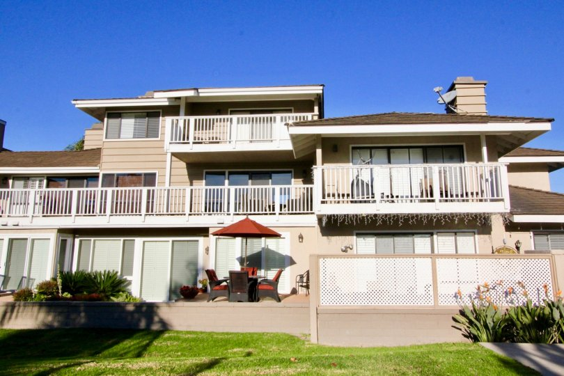 A large three story residential building with white railings at Arborlake in Irvine CA