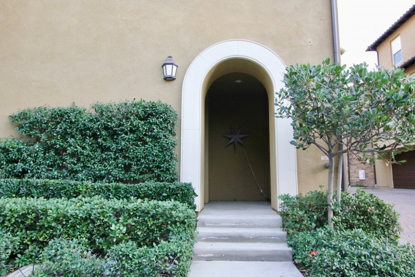 THE FRONT WAY TO THE HOME WITH MANY PLANTS ARE THERE WHICH IS LOCATED IN THE CITY OF IRVINE