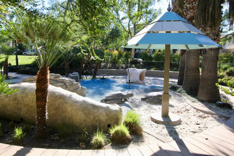 A kids play area with stone turtles and a large shell located at bowen court in irvine ca