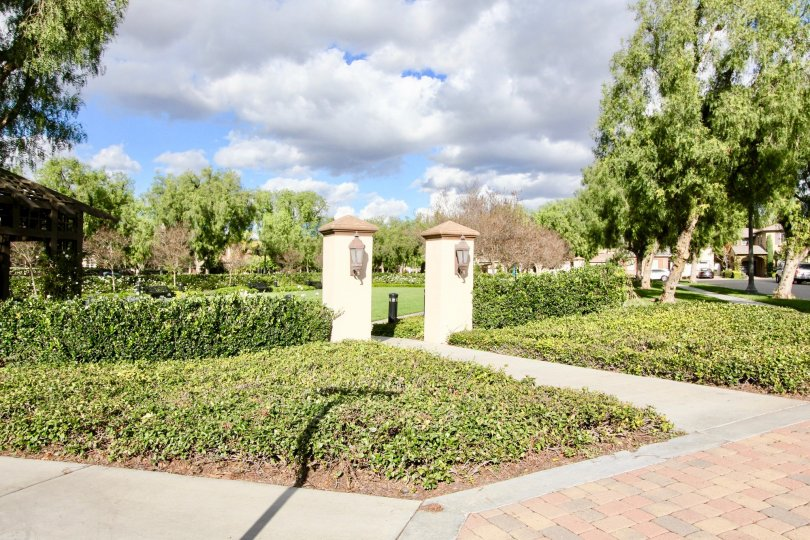 Two large pillars and a walkway inside Brisbane in Irvine California