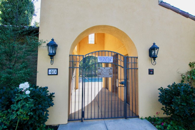 The gated entrance to the pool at Canyon's Edge and surrounding landscaping
