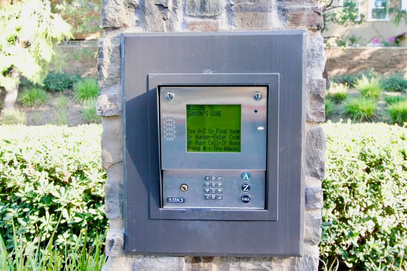 Security keypad with green screen at the entrance of Canyon's Edge in Irvine CA